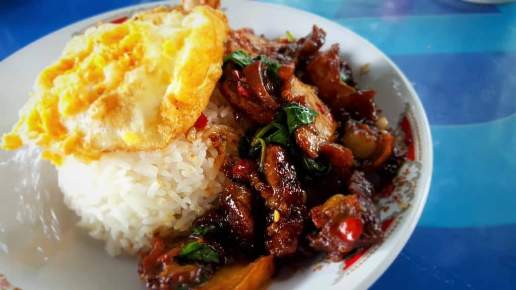 Spicy food; rice and meat on plate
