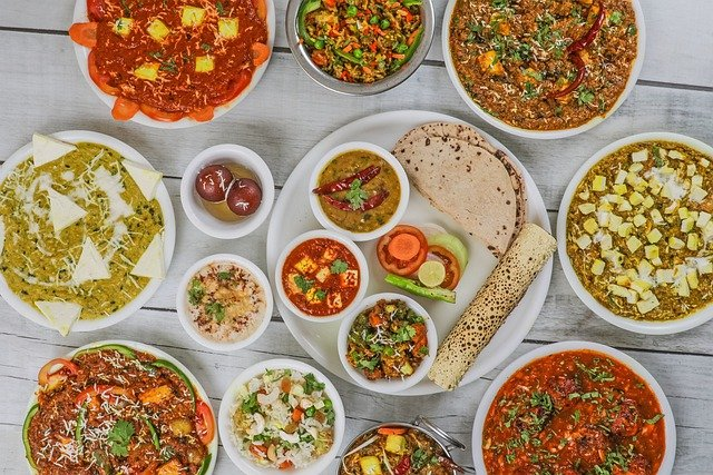 A bowl filled with many different types of food on a table